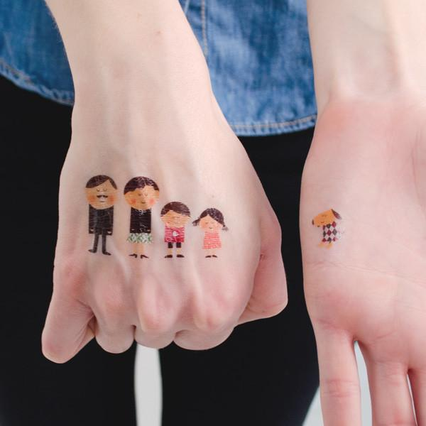 Temporary Tattoo of Four People and a Dog on the Hands of Two People