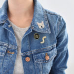 World's Okay-est Dog Mom Pin & Husky Patch on a Jeans Jacket